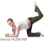 Купить «Активная беременная женщина делает спортивные упражнения на белом фоне. Забота о здоровье и беременность.», фото № 4234769, снято 24 февраля 2012 г. (c) Мельников Дмитрий / Фотобанк Лори