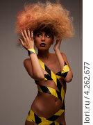 Купить «Стройная смуглая женщина в рыжими волосами в пышной прическе», фото № 4262677, снято 6 июля 2010 г. (c) Syda Productions / Фотобанк Лори