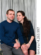 Купить «Счастливая семья. Симпатичные парень и девушка на полосатом фоне», эксклюзивное фото № 4263997, снято 2 февраля 2013 г. (c) Игорь Низов / Фотобанк Лори