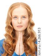 Купить «Юная привлекательная девушка сложила руки перед собой в молитве», фото № 4266913, снято 27 ноября 2010 г. (c) Syda Productions / Фотобанк Лори