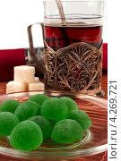 Купить «Стакан чая в подстаканнике и мармелад», фото № 4269721, снято 4 января 2013 г. (c) Андрей Радченко / Фотобанк Лори