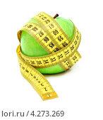Купить «Зеленое яблоко и измерительная лента (изолированно на белом фоне)», фото № 4273269, снято 20 апреля 2011 г. (c) Самохвалов Артем / Фотобанк Лори