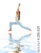 Купить «Стройная девушка с волосами, убранными в хвост, занимается йогой на белом фоне», фото № 4286829, снято 17 июня 2007 г. (c) Syda Productions / Фотобанк Лори