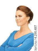 Купить «Привлекательная деловая женщина в голубом джемпере на белом фоне», фото № 4290497, снято 12 марта 2011 г. (c) Syda Productions / Фотобанк Лори