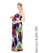 Купить «Молодая беременная женщина с длинными русыми волосами в сарафане на белом фоне», фото № 4291781, снято 12 марта 2011 г. (c) Syda Productions / Фотобанк Лори