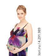 Купить «Молодая беременная женщина с длинными русыми волосами в сарафане на белом фоне», фото № 4291989, снято 12 марта 2011 г. (c) Syda Productions / Фотобанк Лори