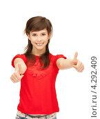 Купить «Девушка в красной рубашке подняла большие пальцы на руках вверх», фото № 4292409, снято 20 марта 2011 г. (c) Syda Productions / Фотобанк Лори
