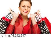 Купить «Счастливая покупательница в красной блузке с пакетами в руках», фото № 4292597, снято 12 марта 2011 г. (c) Syda Productions / Фотобанк Лори