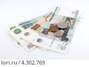 Купить «Деньги на белом фоне», фото № 4302769, снято 22 марта 2012 г. (c) Ирина Геращенко / Фотобанк Лори