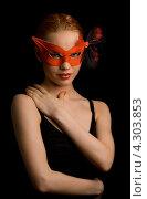 Купить «Девушка в черном платье и красной маске», фото № 4303853, снято 22 февраля 2006 г. (c) Syda Productions / Фотобанк Лори