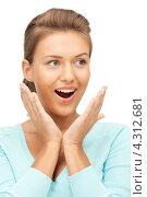 Купить «Красивая юная девушка удивляется на белом фоне», фото № 4312681, снято 28 августа 2011 г. (c) Syda Productions / Фотобанк Лори