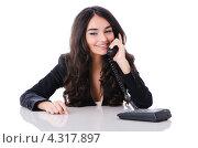 Купить «Девушка разговаривает по телефону, сидя за столом», фото № 4317897, снято 14 января 2012 г. (c) Elnur / Фотобанк Лори