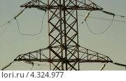 Купить «Высоковольтные опоры. Закат», видеоролик № 4324977, снято 23 февраля 2013 г. (c) Mikhail Erguine / Фотобанк Лори