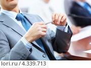 Купить «Крупный план рук бизнесмена на переговорах», фото № 4339713, снято 20 октября 2012 г. (c) Sergey Nivens / Фотобанк Лори