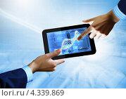 Купить «Изображение спирали ДНК на экране современного планшетного компьютера», фото № 4339869, снято 20 января 2020 г. (c) Sergey Nivens / Фотобанк Лори
