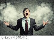 Купить «Дойти до кипения. Бизнесмен с идущим из ушей дымом или паром кричит от злости», фото № 4340445, снято 27 ноября 2012 г. (c) Sergey Nivens / Фотобанк Лори
