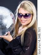 Купить «Привлекательная молодая женщина с диско шаром на вечеринке», фото № 4348161, снято 26 июля 2008 г. (c) Syda Productions / Фотобанк Лори