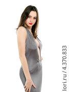 Купить «Элегантная молодая женщина в сером платье с декольте», фото № 4370833, снято 2 марта 2012 г. (c) Сергей Сухоруков / Фотобанк Лори