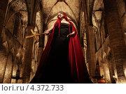 Купить «Женщина с золотым крестом в руке в интерьере собора», фото № 4372733, снято 16 октября 2011 г. (c) Andrejs Pidjass / Фотобанк Лори