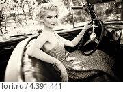 Купить «Молодая женщина сидит в кабриолете», фото № 4391441, снято 14 мая 2012 г. (c) Andrejs Pidjass / Фотобанк Лори