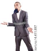 Купить «Бизнесмен окован цепью и кляпом во рту», фото № 4411897, снято 2 октября 2012 г. (c) Elnur / Фотобанк Лори
