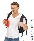 Купить «Счастливый беззаботный турист с рюкзаком на плечах и путеводителем в руке», фото № 4431165, снято 8 апреля 2012 г. (c) Syda Productions / Фотобанк Лори