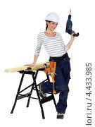 Купить «Девушка-плотник с дрелью у верстака», фото № 4433985, снято 3 марта 2011 г. (c) Phovoir Images / Фотобанк Лори