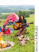 Купить «Друзья с гитарой в походе», фото № 4434261, снято 11 августа 2012 г. (c) CandyBox Images / Фотобанк Лори