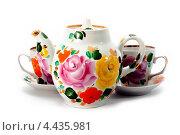 Заварочный чайник и чашки с росписью. Стоковое фото, фотограф CHERKAUSKAS VIKTOR / Фотобанк Лори