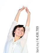 Купить «Красивая улыбающаяся девушка потягивается», фото № 4438789, снято 17 марта 2013 г. (c) Татьяна Белова / Фотобанк Лори