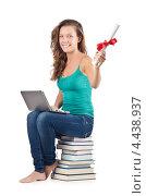 Купить «Студентка сидит на стопке книг с ноутбуком и дипломом», фото № 4438937, снято 22 августа 2012 г. (c) Elnur / Фотобанк Лори