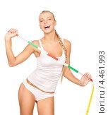 Купить «Стройная молодая женщина с измерительной лентой в руках», фото № 4461993, снято 8 мая 2010 г. (c) Syda Productions / Фотобанк Лори