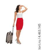 Купить «Привлекательная девушка с чемоданом на белом фоне», фото № 4463145, снято 12 апреля 2012 г. (c) Syda Productions / Фотобанк Лори