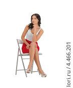Купить «Красивая кокетливая девушка в красной юбке сидит на стуле», фото № 4466201, снято 12 апреля 2012 г. (c) Syda Productions / Фотобанк Лори