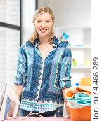 Купить «Довольная домохозяйка гладит утюгом дома белье», фото № 4466289, снято 17 июня 2012 г. (c) Syda Productions / Фотобанк Лори