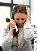 Купить «Уставшая деловая женщина с телефонной трубкой в офисе», фото № 4466497, снято 16 июля 2011 г. (c) Syda Productions / Фотобанк Лори