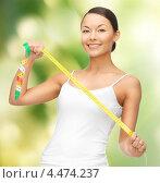 Купить «Соблазнительная стройная девушка измеряет тело сантиметром», фото № 4474237, снято 12 января 2013 г. (c) Syda Productions / Фотобанк Лори