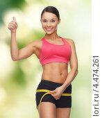 Купить «Молодая спортивная женщина измеряет объем бедер», фото № 4474261, снято 12 января 2013 г. (c) Syda Productions / Фотобанк Лори