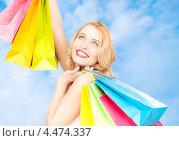 Купить «Радостная девушка с покупками после удачного похода по магазинам», фото № 4474337, снято 28 марта 2010 г. (c) Syda Productions / Фотобанк Лори