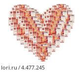 Купить «Сердце из пятитысячных  купюр», эксклюзивное фото № 4477245, снято 9 февраля 2013 г. (c) Юрий Морозов / Фотобанк Лори