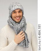 Купить «Привлекательный молодой человек в свитере, шапке и шарфе», фото № 4484181, снято 7 октября 2012 г. (c) Syda Productions / Фотобанк Лори