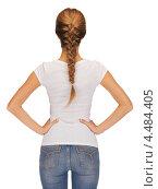 Купить «Стройная девушка в белой футболке стоит, повернувшись спиной», фото № 4484405, снято 16 сентября 2012 г. (c) Syda Productions / Фотобанк Лори
