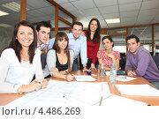 Купить «Коллеги за рабочим столом в офисе», фото № 4486269, снято 13 февраля 2010 г. (c) Phovoir Images / Фотобанк Лори