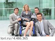 Купить «Женщина в инвалидной коляске с коллегами», фото № 4486365, снято 14 июня 2010 г. (c) Phovoir Images / Фотобанк Лори