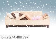 Купить «Девушка лежит на софе среди множества подушек», фото № 4488797, снято 3 апреля 2010 г. (c) Syda Productions / Фотобанк Лори