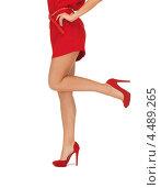 Купить «Красивая молодая женщина со светлыми волосами в элегантном красном платье и на каблуках на белом фоне», фото № 4489265, снято 7 октября 2012 г. (c) Syda Productions / Фотобанк Лори