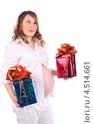 Купить «Беременная женщина с подарочными коробками», фото № 4514661, снято 6 февраля 2012 г. (c) Losevsky Pavel / Фотобанк Лори