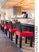 Купить «Красные стулья около барной стойки в суши-ресторане», фото № 4514861, снято 26 мая 2011 г. (c) Losevsky Pavel / Фотобанк Лори