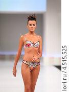 Купить «Модель в цветастом купальнике на подиуме», фото № 4515525, снято 7 сентября 2011 г. (c) Losevsky Pavel / Фотобанк Лори