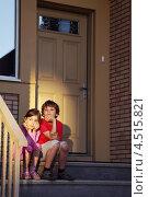 Купить «Брат с сестрой сидят на крыльце загородного дома вечером», фото № 4515821, снято 4 июня 2011 г. (c) Losevsky Pavel / Фотобанк Лори